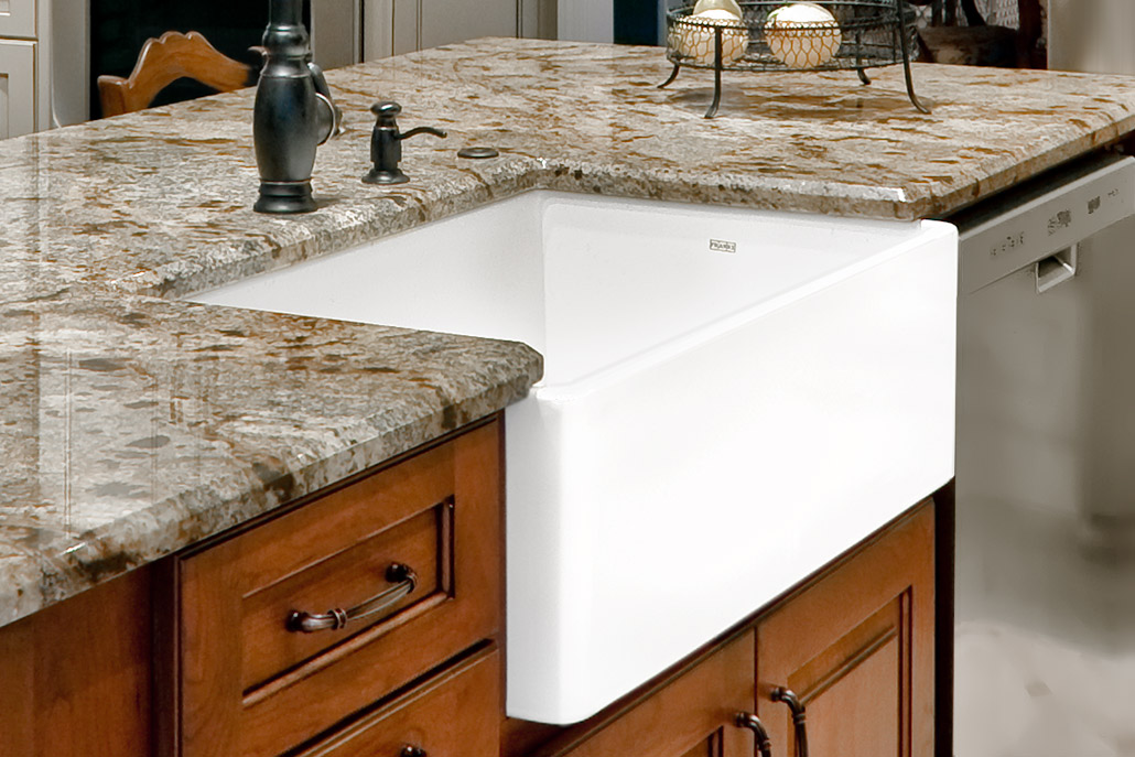 Color photograph of white apron front sink