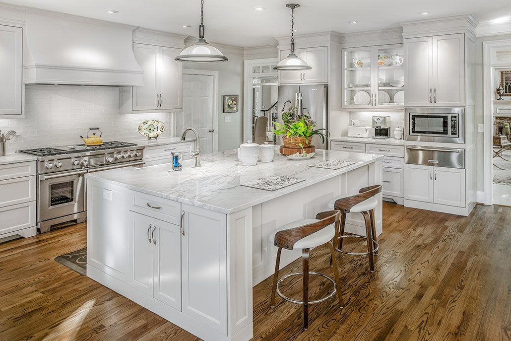 White kitchen with quartzite countertops and custom cabinets