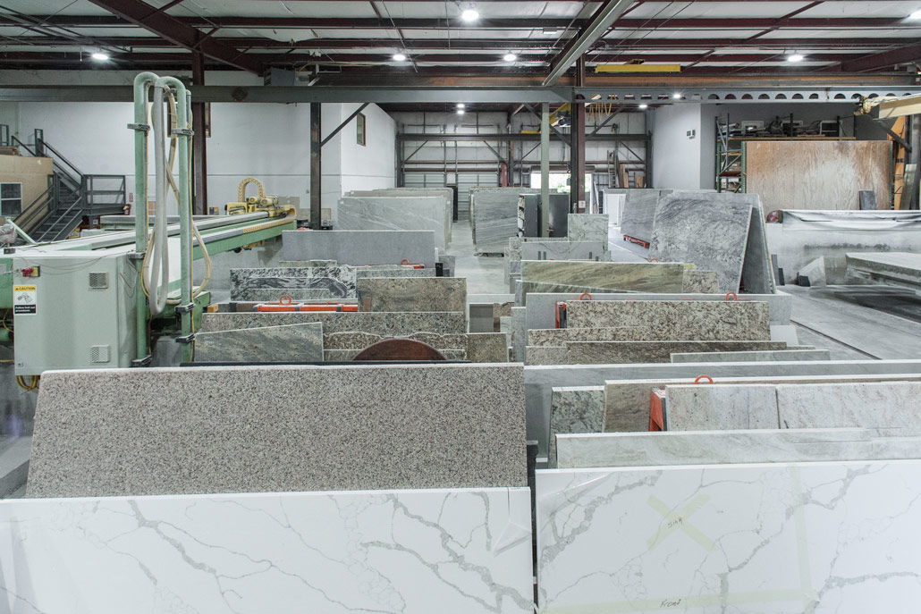 Color photograph partial view of countertop slab inventory at Affinity Stoneworks