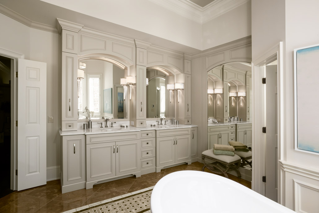 Color photograph of transitional en suite bathroom featuring custom cabinets