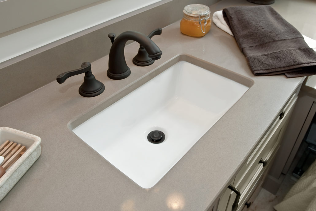Color photograph of white trench sink